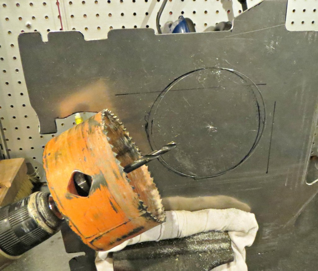 Beg, Borrow, or buy a 4 inch hole saw. this makes life a whole lot easier!
